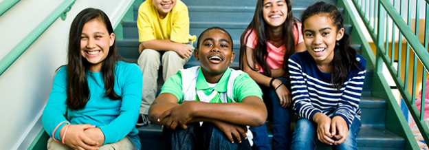 Group of kids sitting on staircase